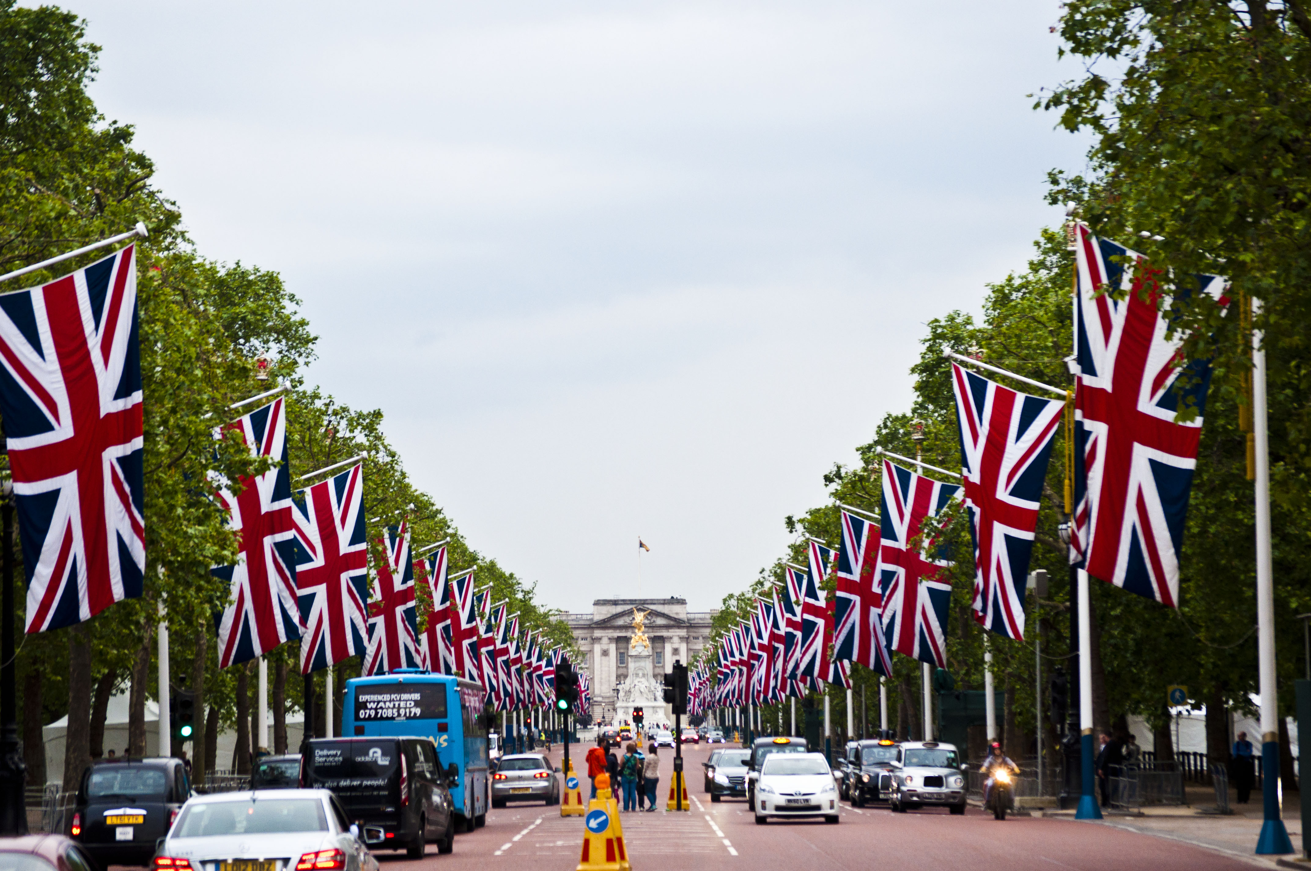 London Street leading to Buckingham Palace with British flags and trees lining the sides of the road