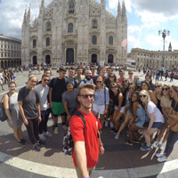 student group taking a selfie in front of the Duomo in Milan