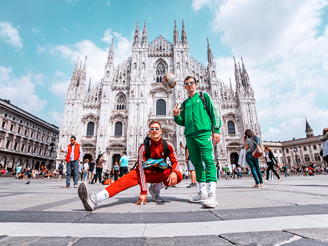 Two students with a soccer ball in front of Il Duomo & Piazza del Duomo