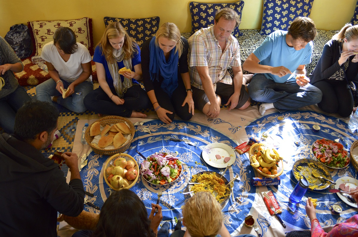 Students Sitting in a Circle on the Floor Sharing Traditional Moroccan Food