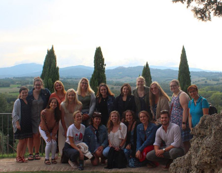 A group on a field trip in the Tuscan countryside