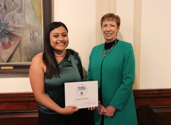 Yesenia Ayala holding Global Citizen of the Year certificate next to IES Abroad CEO Mary M. Dwyer