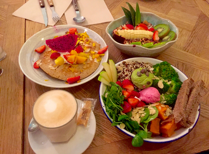 Brunch dishes with fruit and coffee in Barcelona