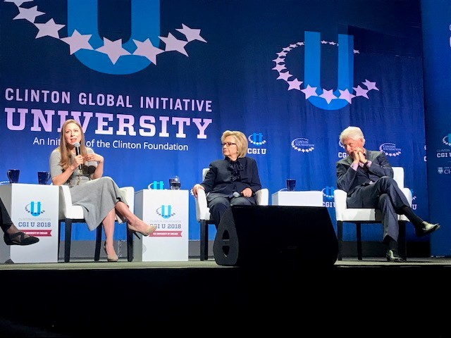 Chelsea Clinton, Hilary Clinton, and Bill Clinton sitting on stage at the Clinton Global Initiative University Conference
