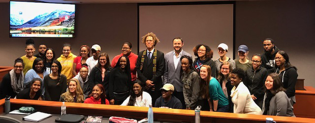 Professor Cesar Tacchi and Professor David Neita visit with students at Howard University