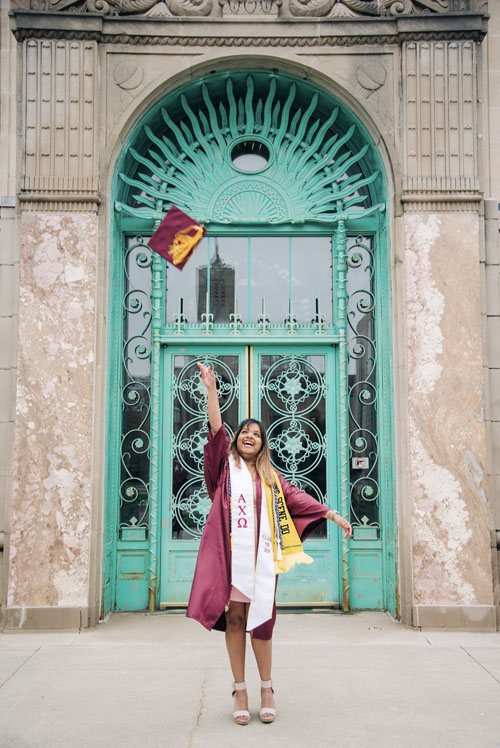 Dayna tossing her cap at graduation from Loyola University Chicago