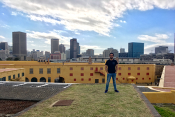 Intern in Cape Town on Rooftop in Front of Skyline