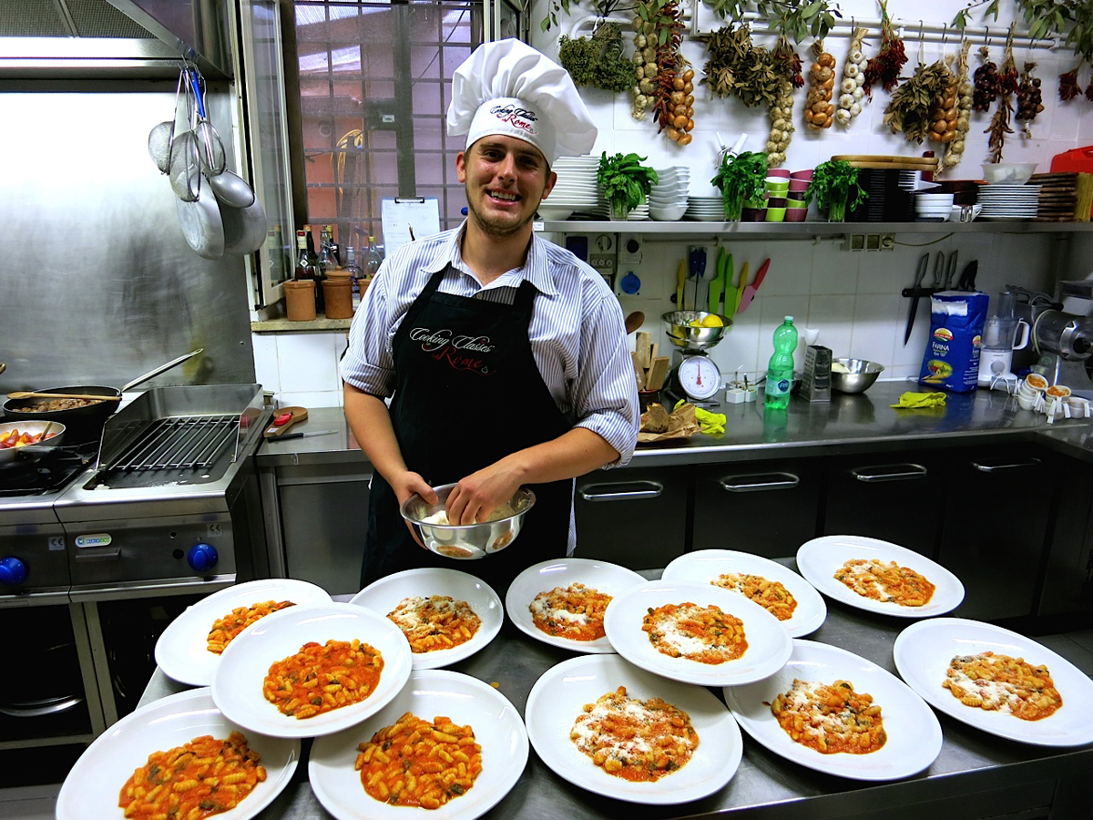 Student interning in Rome standing in kitchen