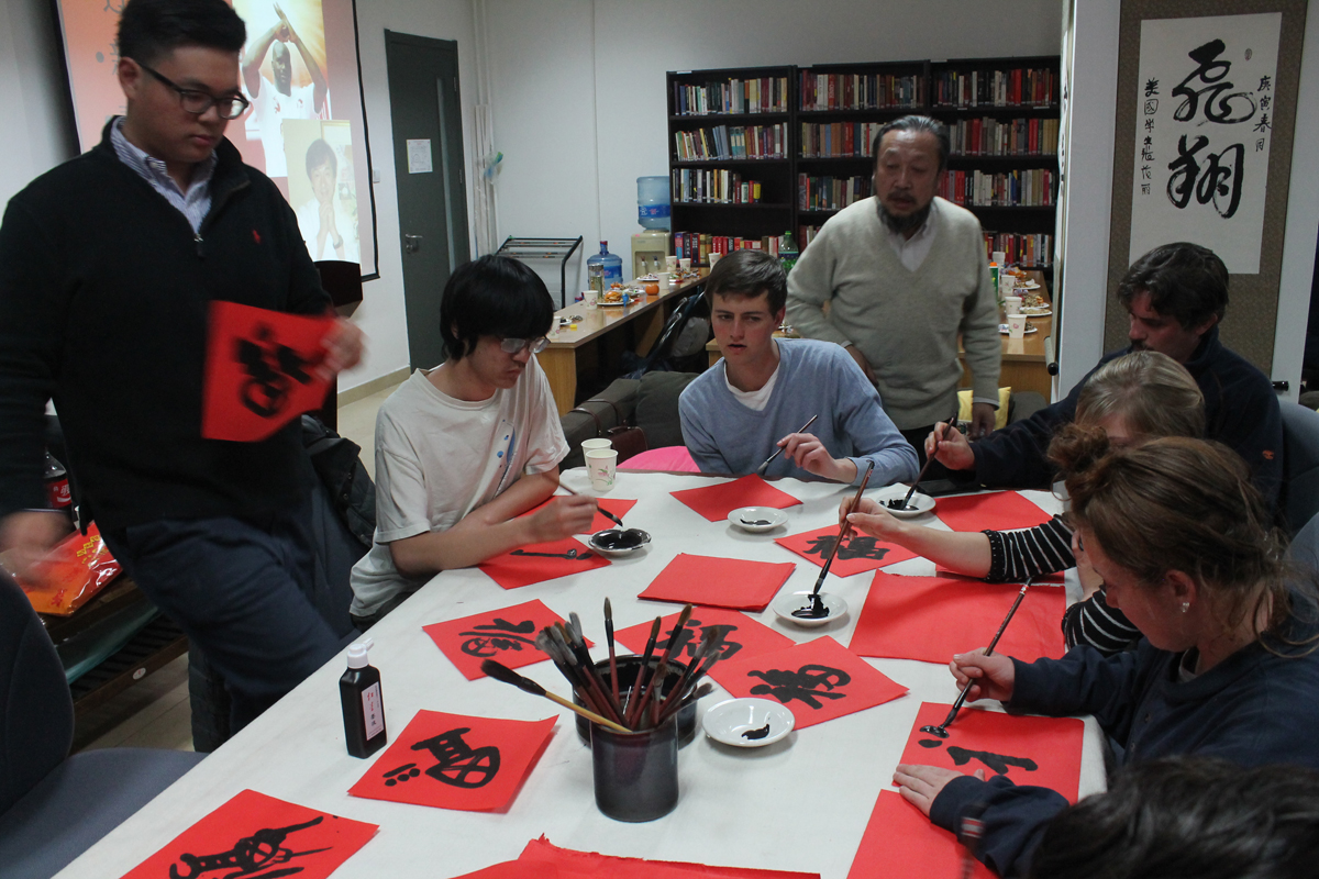 Students practicing chinese calligraphy