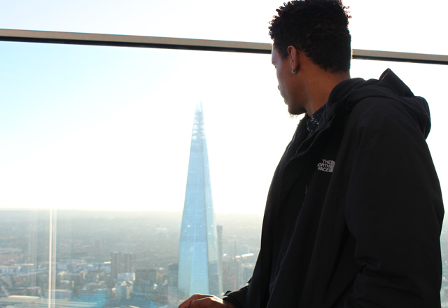student looking out from sky garden in london, uk