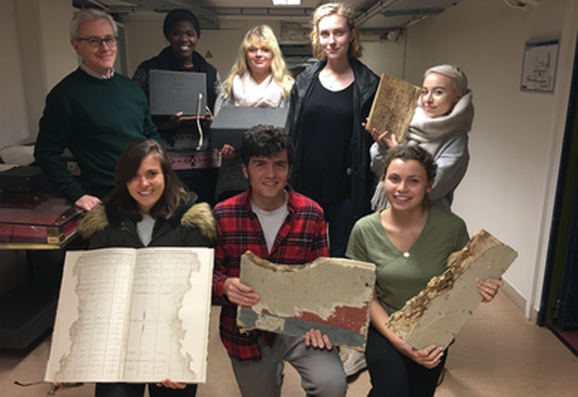 IES Abroad Nantes students visiting archives with Professor Charlot