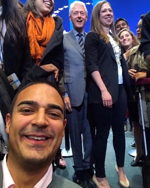 Hernando Sevilla-Garcia taking a selfie with Bill Clinton and Chelsea Clinton and other CGI-U students