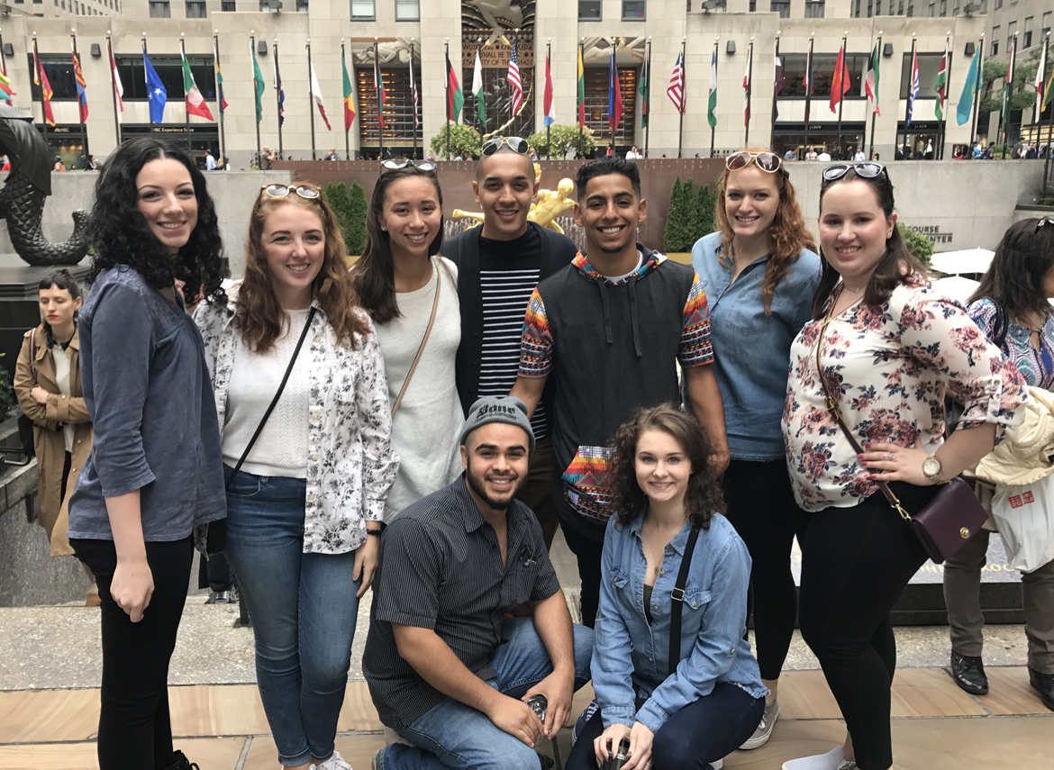 Group of students from Augustana College posing together in Rockefeller Plaza
