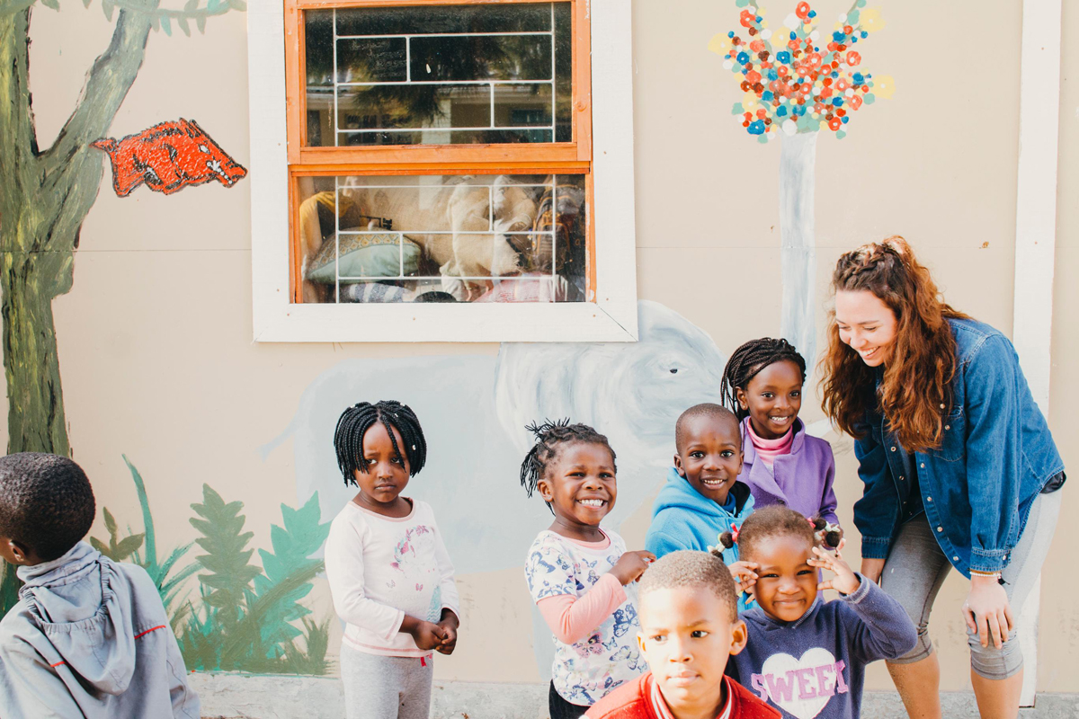 Student with small children in Cape Town