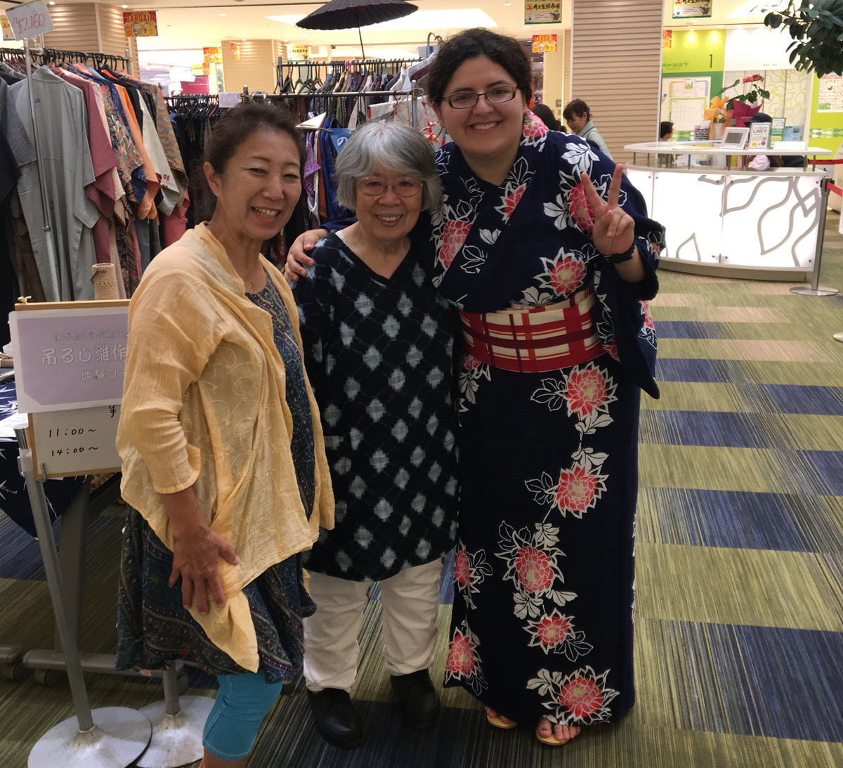 Student in kimono with host family