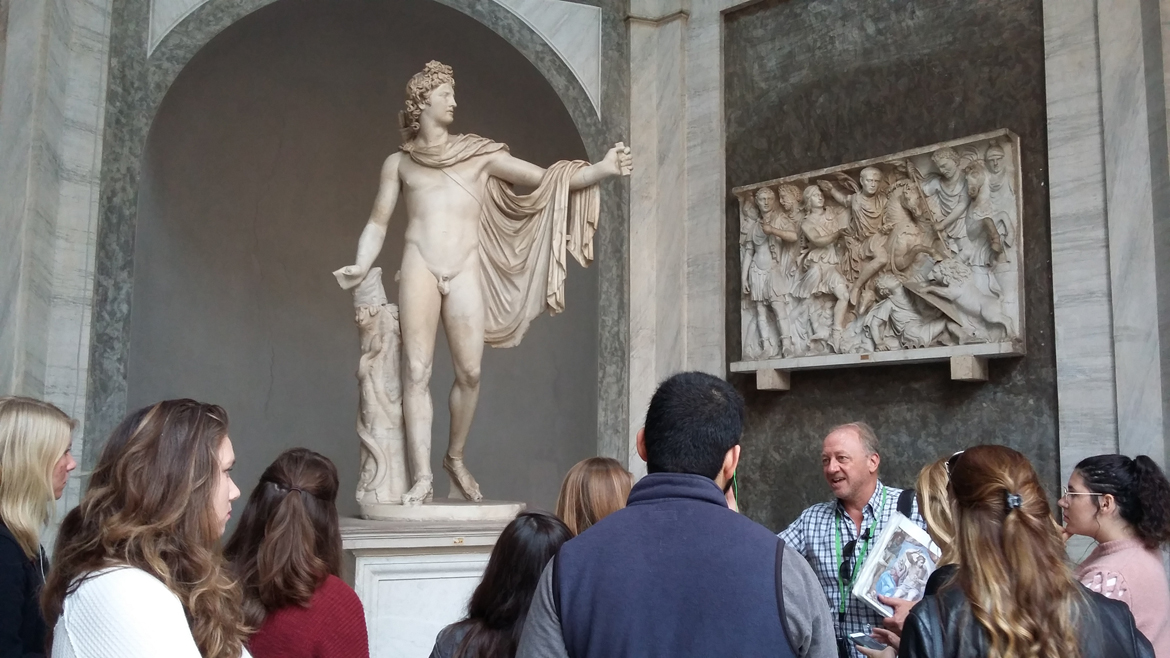 students observe statue at the Vatican museum in Rome