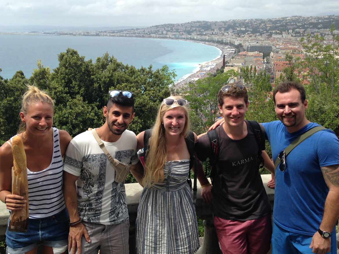 students standing in front of nice skyline and coastline