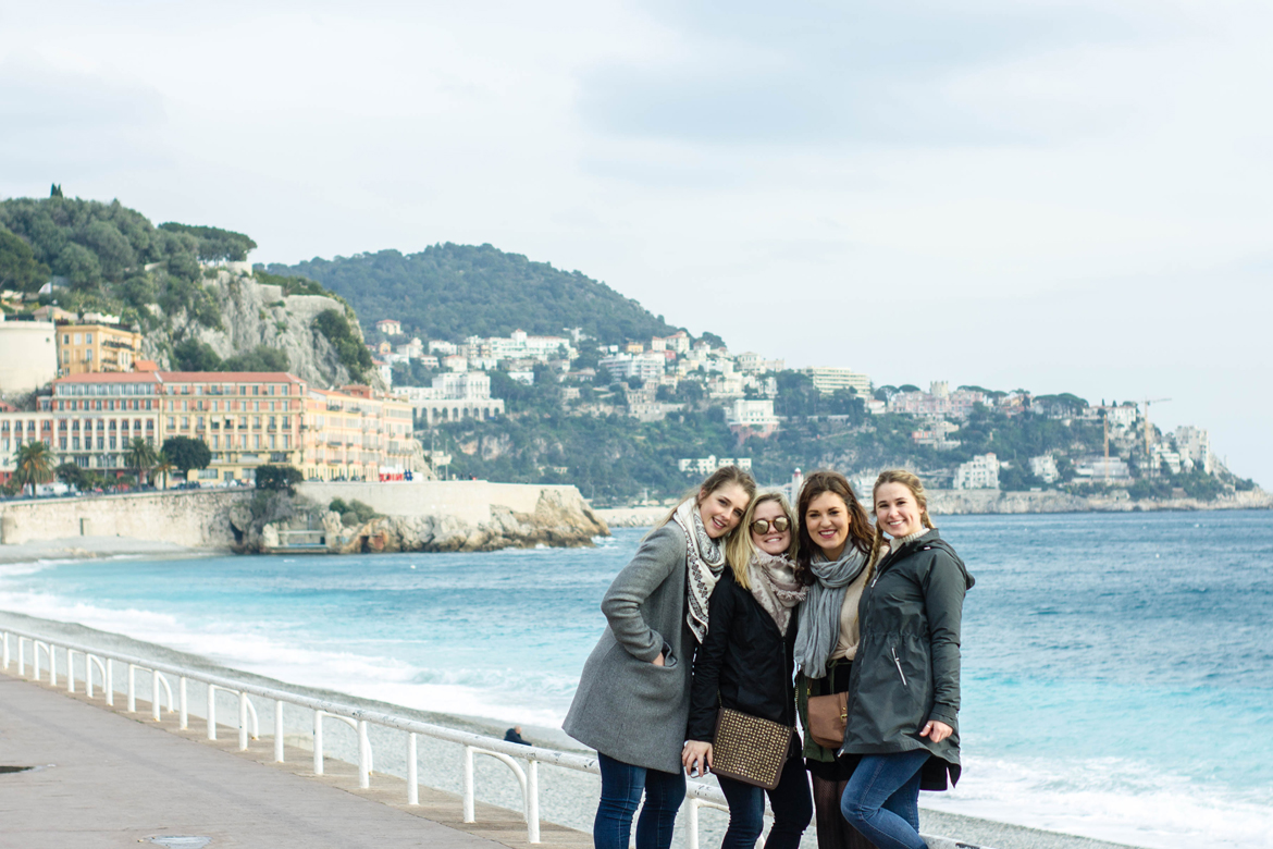 three students standing along ocean in Nice, France