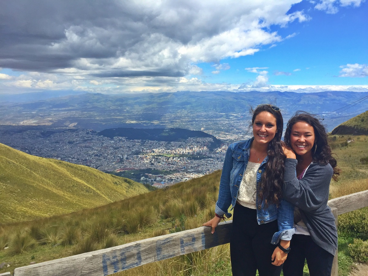 Two IES Abroad students pose in front of scenic, green, landscape in Ecuador