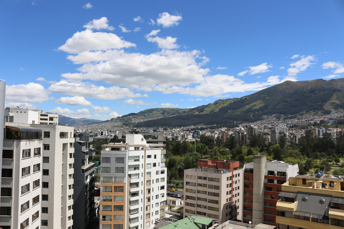city view of quito, ecuador with mountaints in background