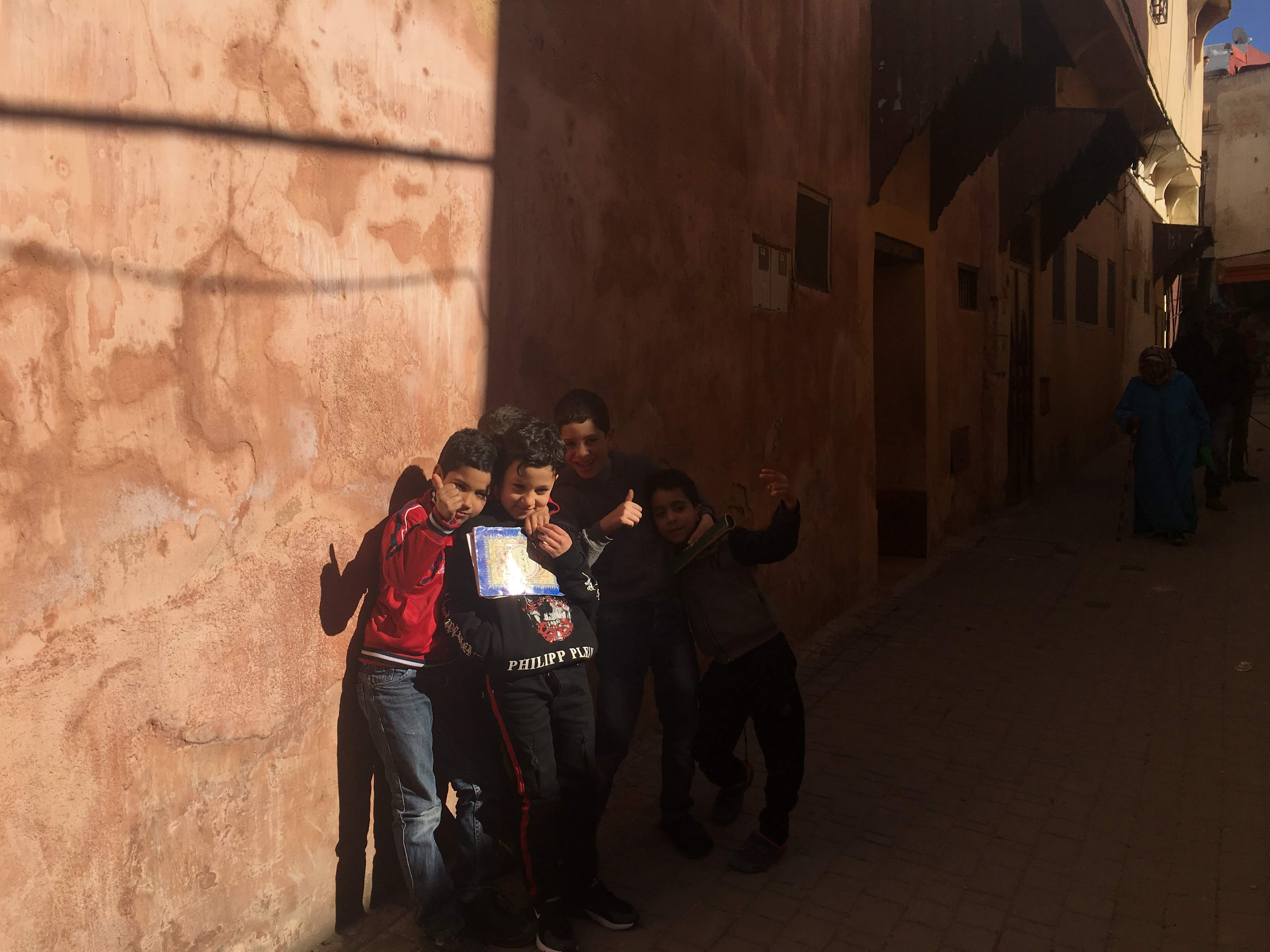 a group of young boys pose for a photo