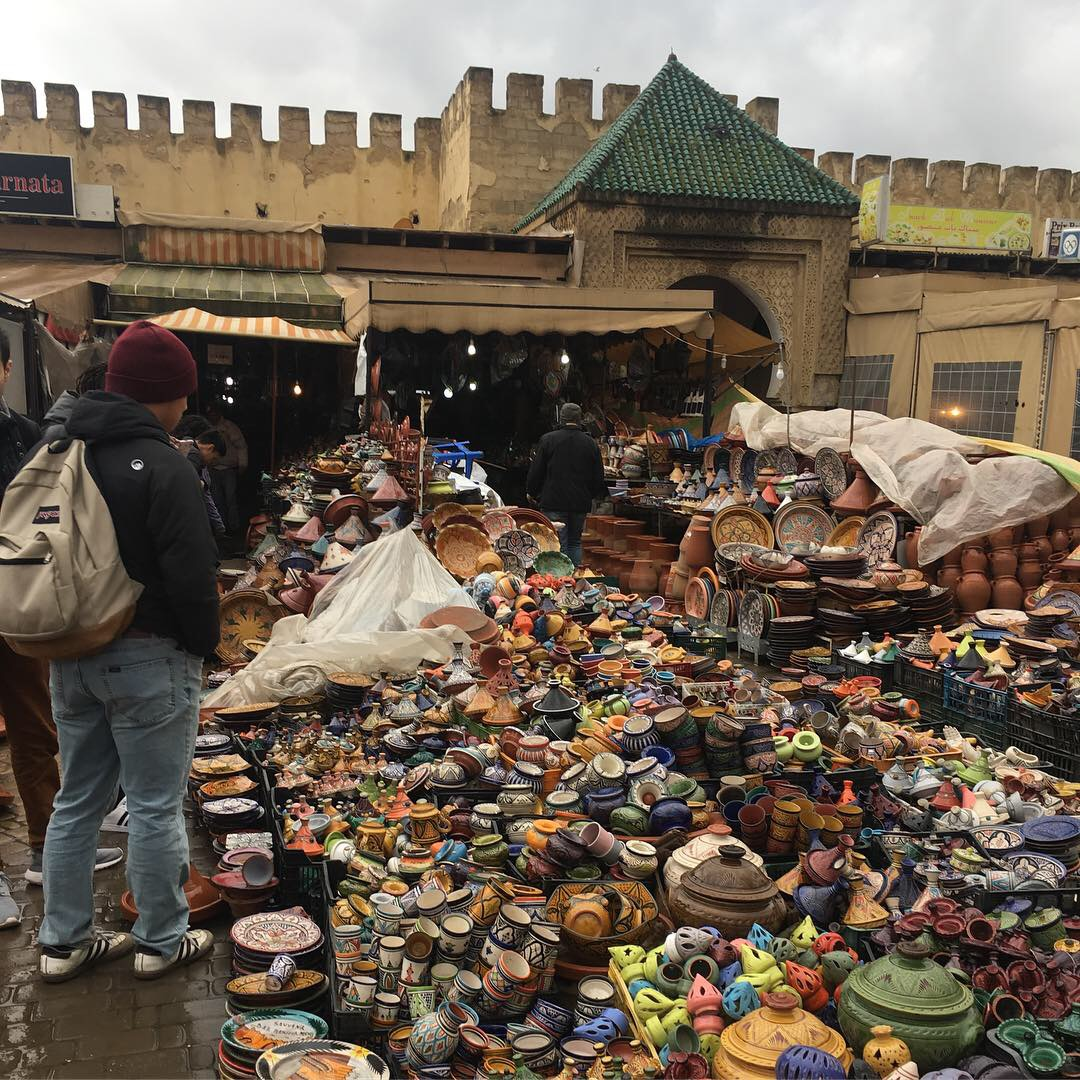 a pile of pottery in a market