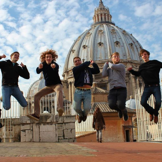 Students jumping in front of Vatican