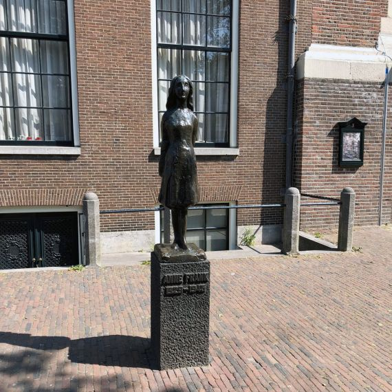 Anne Frank statue outside of Anne Frank House