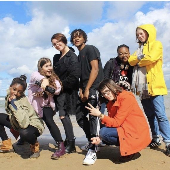 Group of students posing on beach in Normandy, France
