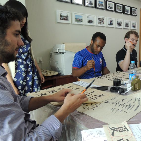 students in calligraphy class