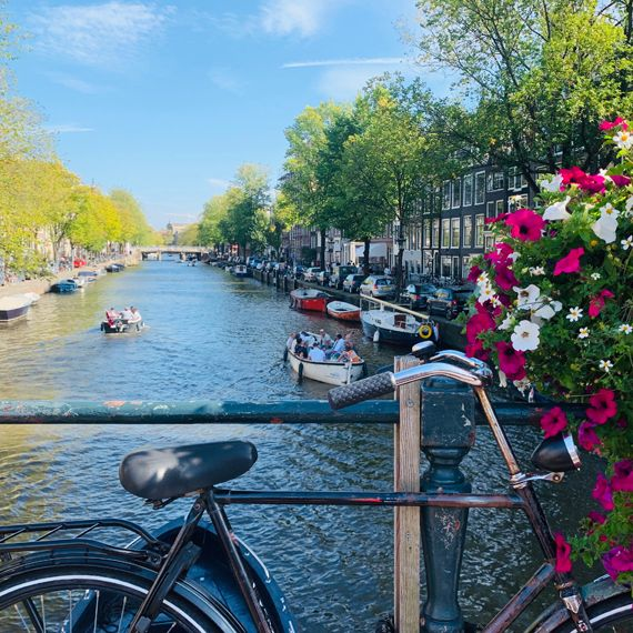 Bike and flowers in front of canal