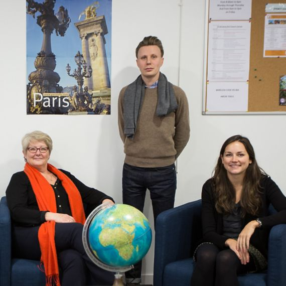 center staff with a globe