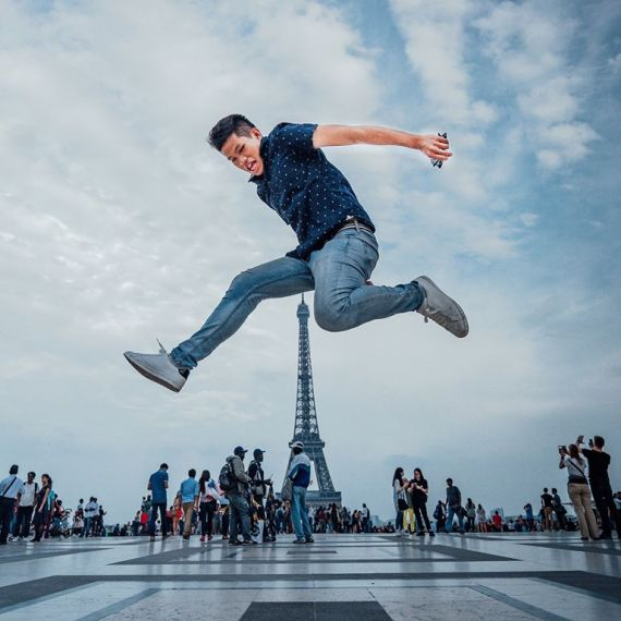 Student jumps near the Eiffel Tower