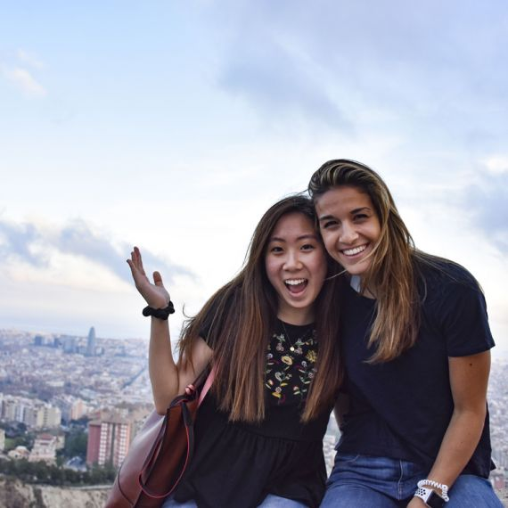 two spanish study abroad students sitting at los bunkers in Barcelona, Spain