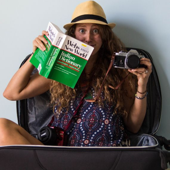 student with camera and Italian dictionary