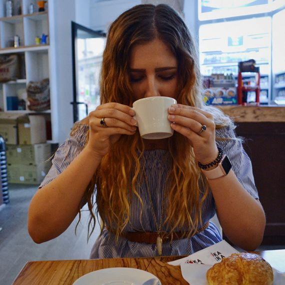Female drinking cup of coffee
