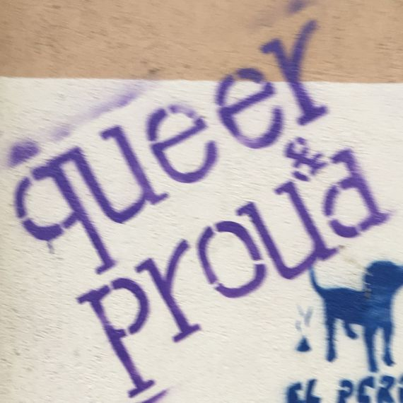 "street art that reads ""queer and proud"""