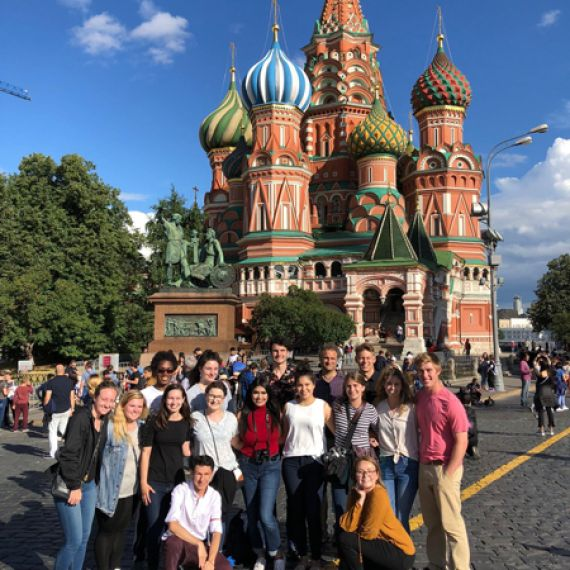 students in front of St. Basil's Cathedral in Moscow Kremlin