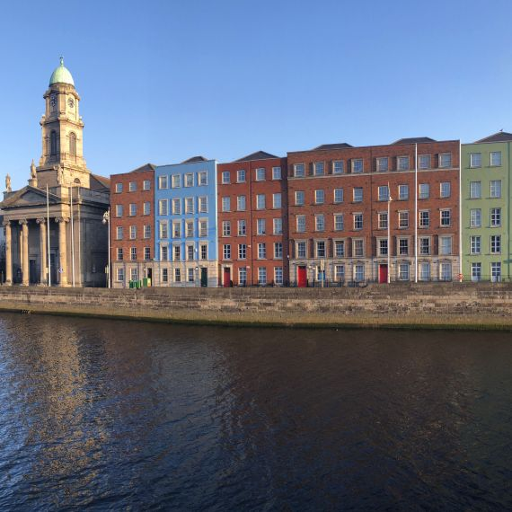 Colored houses along the river liffey in dublin, ireland
