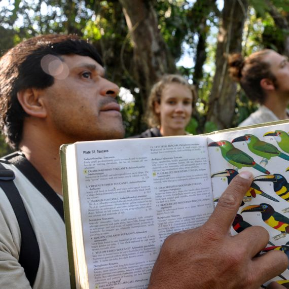 professor and students bird watching in the Galapagos Islands