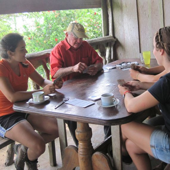 spanish study abroad students with a host family playing cards in Galapagos Islands, Ecuador