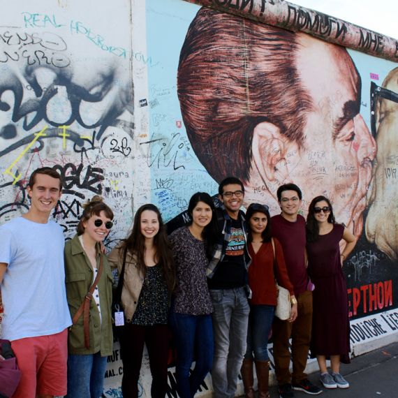 students in front of the Berlin wall