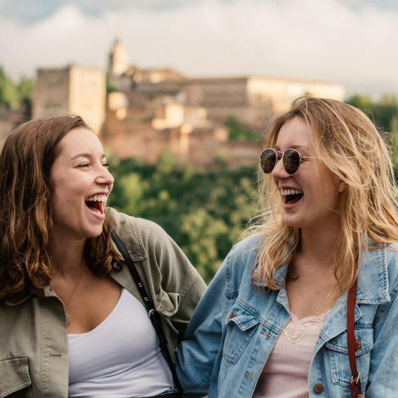 spanish study abroad students laughing together in Granada, Spain by the Alhambra