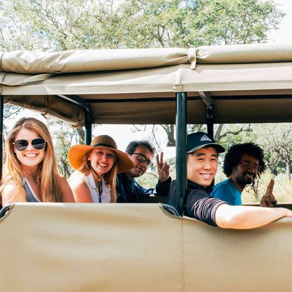students riding in safari jeep in south africa