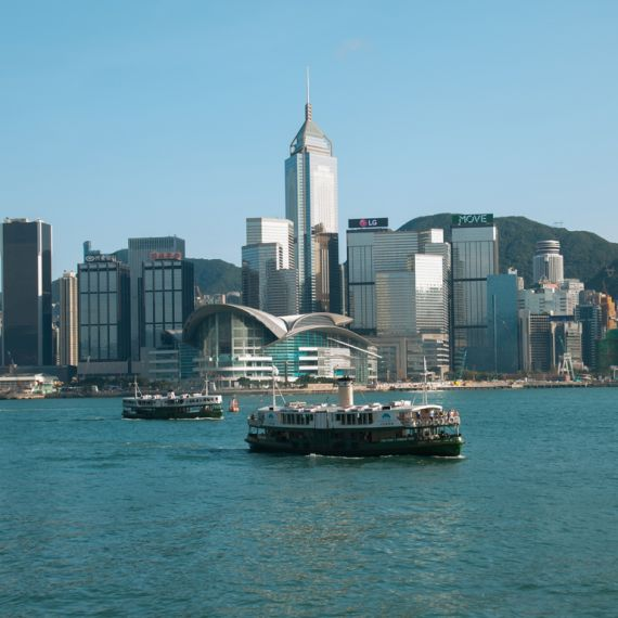 Hong Kong Skyline with ferry in Victoria Harbour