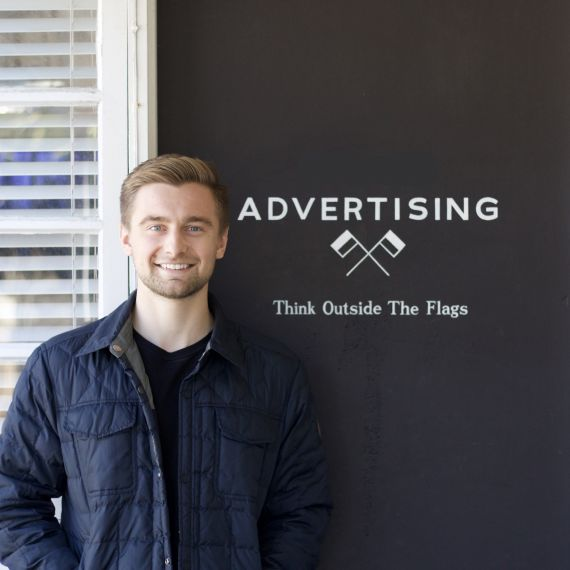 Intern in front of advertising agency