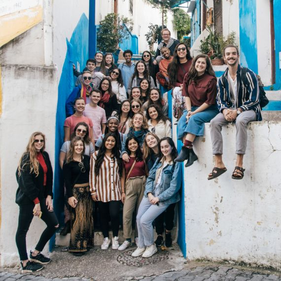 students standing for group photo in a stairway in morocco