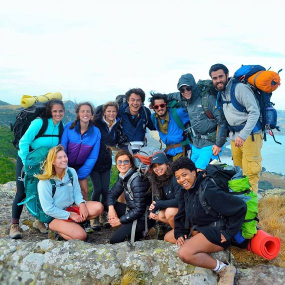 group of students with backpacking gear in new zealand