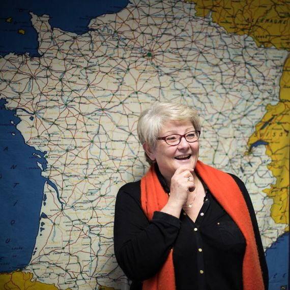 Paris BIA Center Director in front of map of France