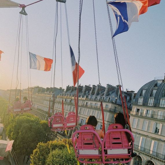 Students riding swings in Paris